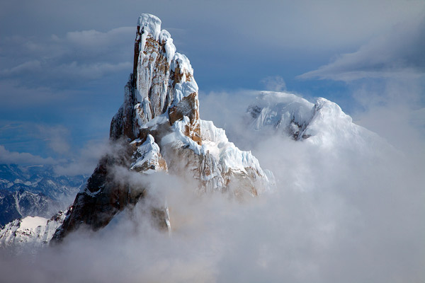 CERRO TORRE LIFTING OUT OF A PATAGONIAN STORM